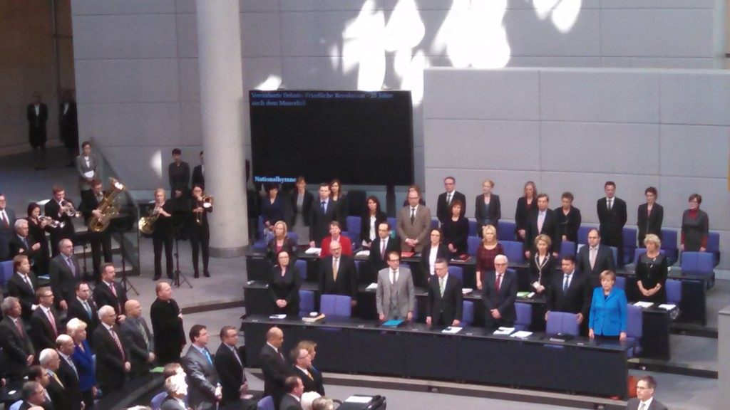 Chancellor Merkel in blue jacket
