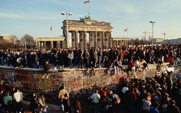 Crowds at the Brandenburg Gate bear witness to the Fall of the Berlin Wall. Picture: GETTY